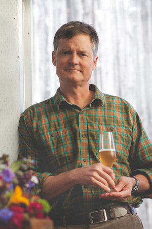 Image of Gordon holding a glass of mead